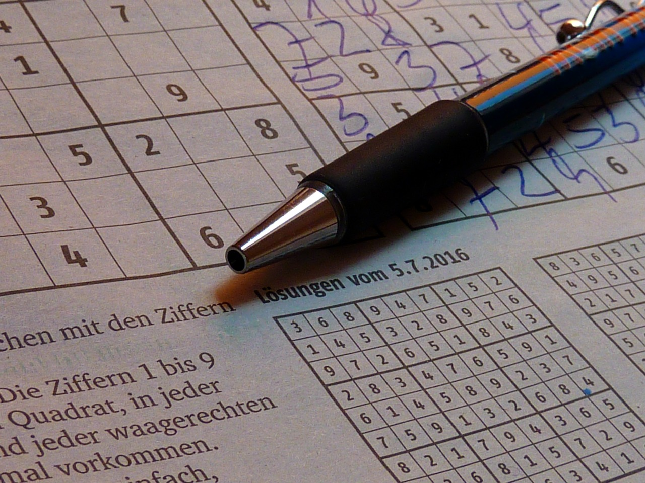pencil and sudoku puzzle
