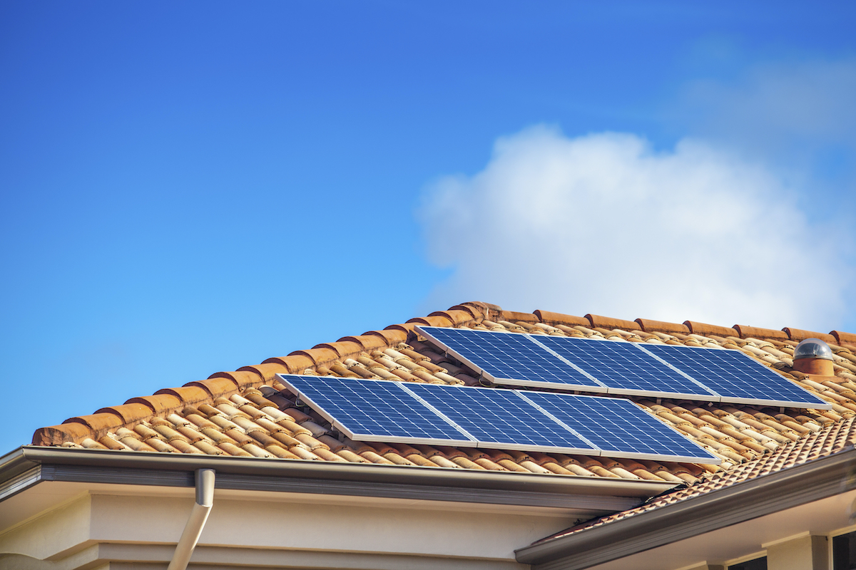 home with solar panel roofing